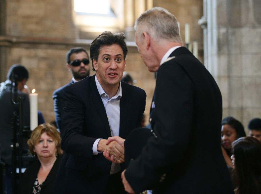 Former Labour leader Ed Miliband (left) with Metropolitan Police Commissioner Sir Bernard Hogan-Howe (Yui Mok - WPA Pool /Getty Images)