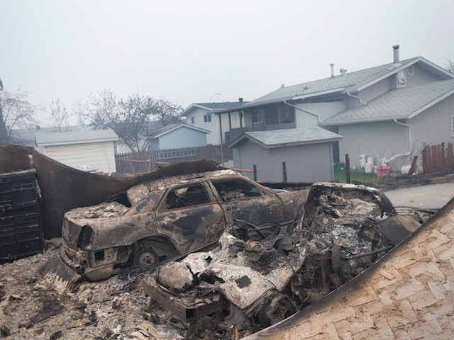 Fort McMurray (AB) Canada  city photos : FORT MCMURRAY, AB MAY 07: The remains of charred vehicles sit in a ...