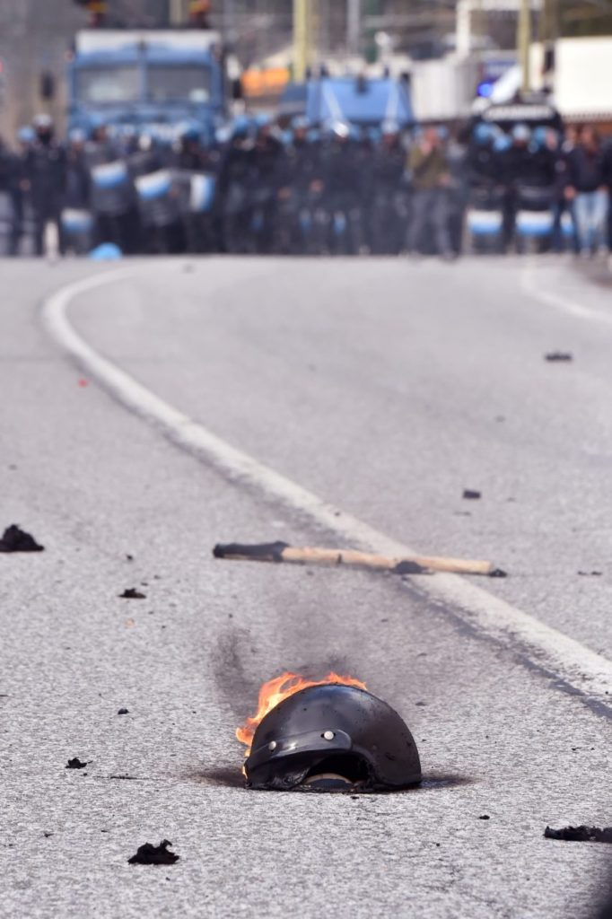 A helmet burns during clashes (GIUSEPPE CACACE/AFP/Getty Images)