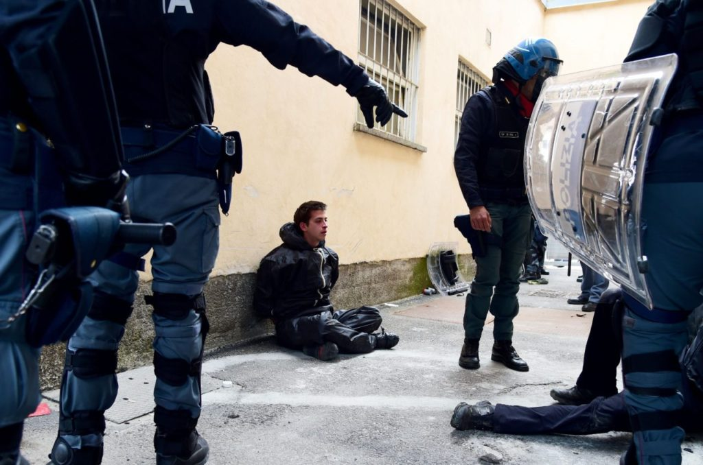 """A """"No border"""" activist is arrested by Italian police (GIUSEPPE CACACE/AFP/Getty Images)"""