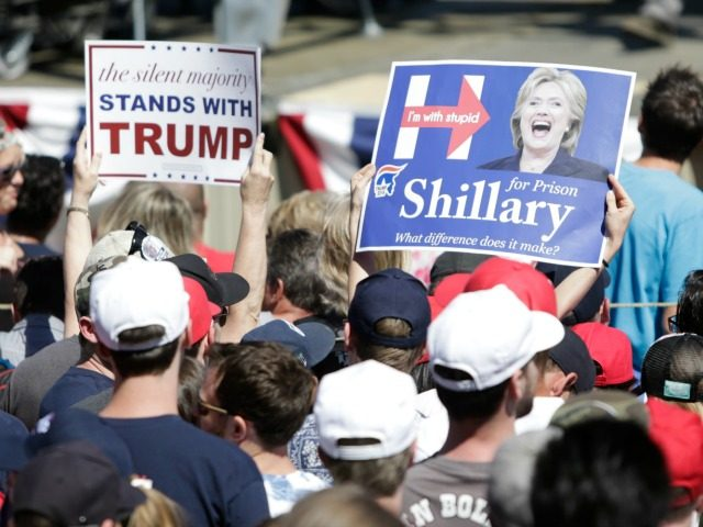 A supporter holds a sign mocking Democratic presidential candidate Hillary Clinton during a campaign stop for US Republican presidential candidate Donald Trump at the Northwest Washington Fair and Event Center in Lynden, Washington on May 7, 2016.
