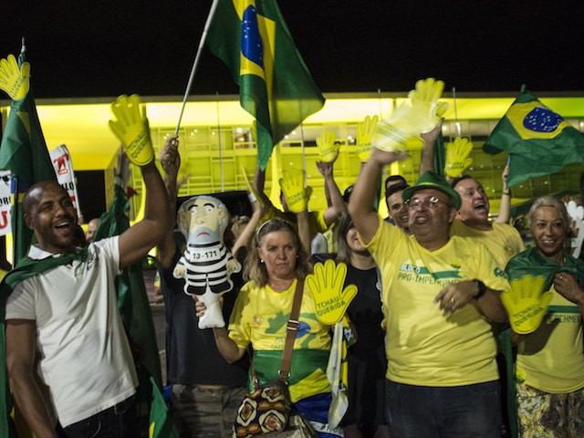 People demonstrate in support of the impeachment of Brazilian President Dilma Rousseff in front of Planalto Palace in Brasilia, on May 10, 2016. Rousseff vowed Tuesday to serve out her full term, on the eve of a Senate vote on opening an impeachment trial that could mark her last day in office. Rousseff is accused of using accounting tricks and unauthorized state loans to boost public spending during her 2014 re-election campaign. She argues the same accounting techniques were used regularly by previous governments and fall far short of an impeachable offense. / AFP / VANDERLEI ALMEIDA (Photo credit should read VANDERLEI ALMEIDA/AFP/Getty Images)