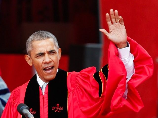 U.S. President Barack Obama waves to the crowd during the 250th anniversary commencement ceremony at Rutgers University on May 15, 2016 in New Brunswick, New Jersey.