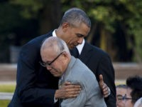 US President Barack Obama hugs Shigeaki Mori (front), a survivor of the 1945 atomic bombing of Hiroshima, during a visit to the Hiroshima Peace Memorial Park on May 27, 2016. Obama on May 27 paid moving tribute to victims of the world's first nuclear attack.   / AFP / JIM WATSON        (Photo credit should read