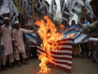 Pakistani supporters of the banned fundamentalist organisation Jamaat-ud-Dawa (JuD) burn a US flag in a protest in Peshawar on May 27, 2016, against the US drone strike in Pakistani soil that killed Taliban leader Mullah Akhtar Mansour. A US drone strike killed Taliban chief Mullah Akhtar Mansour in a remote …