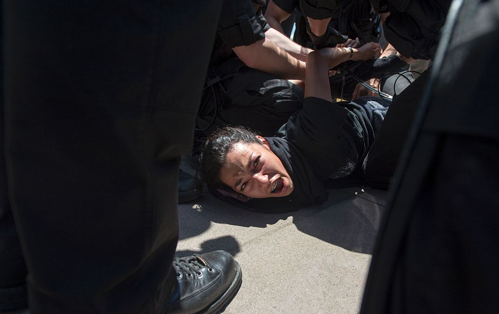 Police arrest a protester following a rally where republican presidential candidate Donald Trump spoke in Fresno, California on May 27, 2016. / AFP / JOSH EDELSON (Photo credit should read JOSH EDELSON/AFP/Getty Images)