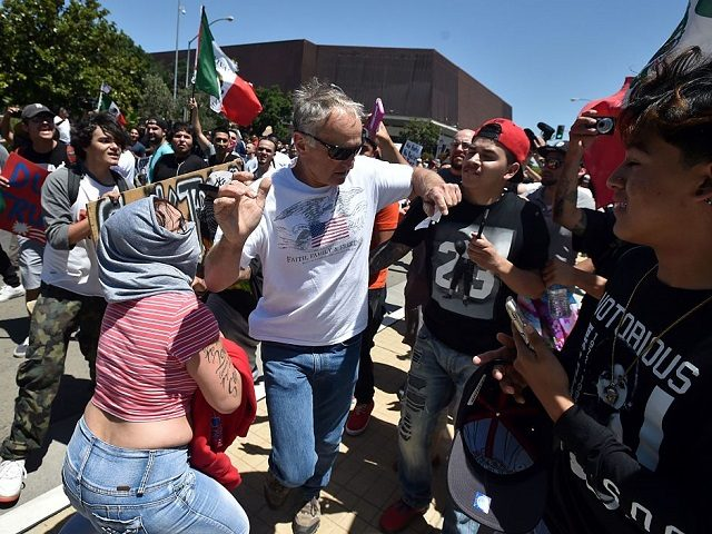 Protesters surround and taunt a man as he leaves a rally where republican presidential candidate Donald Trump spoke in Fresno, California on May 27, 2016. / AFP / JOSH EDELSON (Photo credit should read JOSH EDELSON/AFP/Getty Images)