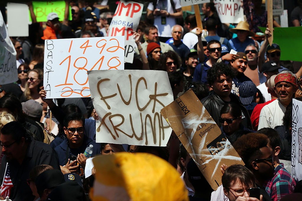SAN DIEGO, CA - MAY 27: Demonstrators protest outside of an arena where the presumptive Republican presidential candidate Donald Trump is holding a rally in San Diego on May 27, 2016 in Fresno, California. Trump is on a western campaign trip which saw stops in North Dakota and Montana yesterday and two more in California today. (Photo by Spencer Platt/Getty Images)