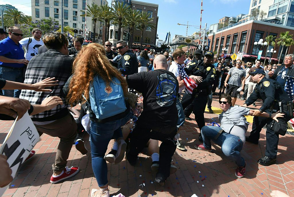 Protesters and supporters of Republican presidential candidate Donald Trump clash during a rally outside Trump's event in San Diego, California, on May 27, 2016. / AFP / Mark Ralston (Photo credit should read MARK RALSTON/AFP/Getty Images)