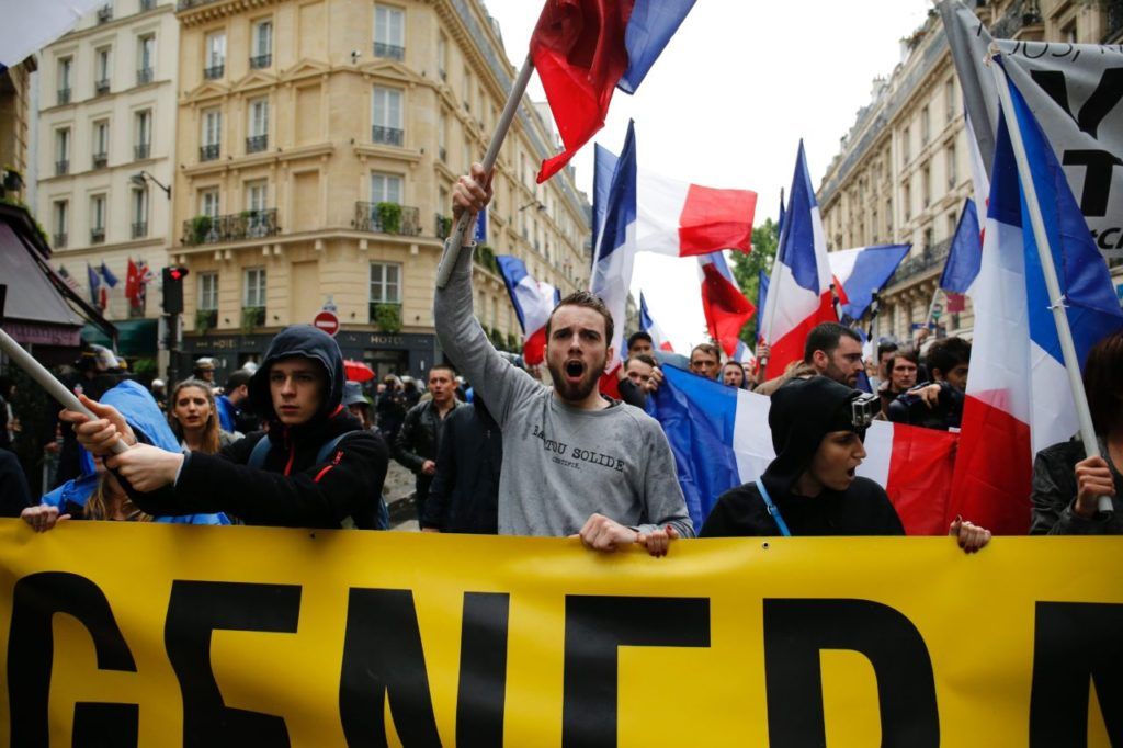 Protesters from far-right movement Generation Identitaire take part in a demonstration against migrants on May 28, 2016 in Paris. / AFP / MATTHIEU ALEXANDRE (Photo credit should read MATTHIEU ALEXANDRE/AFP/Getty Images)