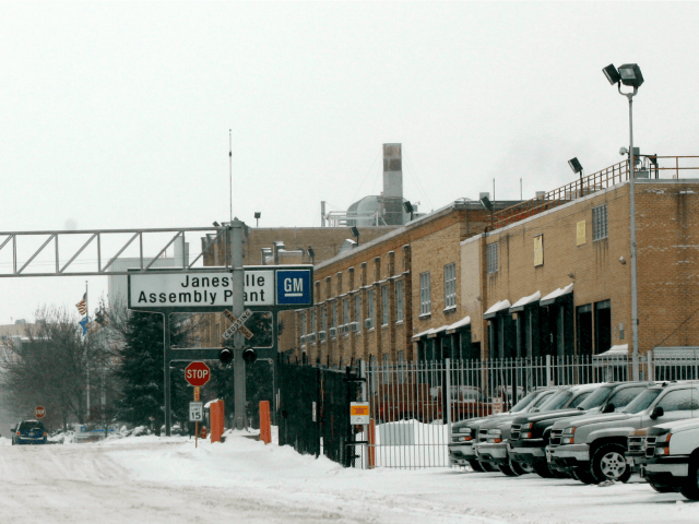 A worker walks to his vehicle after their final production line duties at the Janesville GM plant December 23, 2008 in Janesville, Wisconsin.