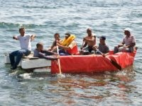 Seven would-be Cuban emigres remain in a homemade boat moments before being arrested by Cuban military agents after their attempt to escape from the island nation was thwarted by the sea currents, on June 4, 2009 in Havana. The boat-people's raft was brought back to the coast just in front …