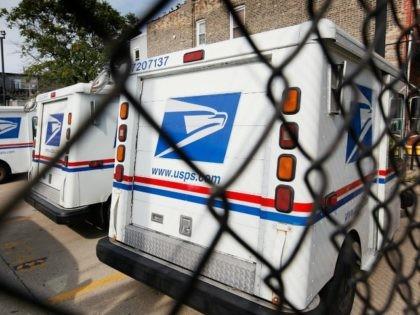 United States Postal Service trucks August 25, 2009 in Chicago, Illinois.
