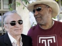 Hefner and Cosby (Reed Saxon / Associated Press)