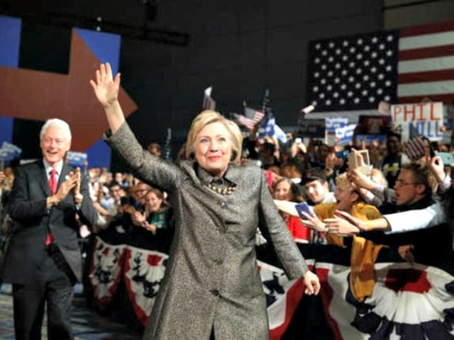 FILE - In this April 26, 2016 file photo, Democratic presidential candidate Hillary Clinton, accompanied by former President Bill Clinton walks to stage at her presidential primary election night rally in Philadelphia. (AP Photo/Matt Rourke, File)