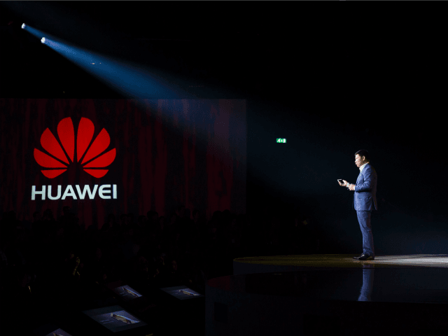 CEO of Consumer Business Group of Chinese tech company Huawei, Richard Yu, addresses the audience to launch the Huawei P9 smartphone during a press conference at Battersea Evolution in London on April 6, 2016.