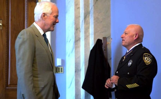 Senator John Cornyn meets with Garland Police Officer Gregory Stevens after he received the Public Safety Officer Medal of Valor.