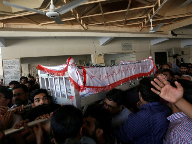 Relatives carry the coffin of Khurram Zaki who was shot by gunmen, during his funeral in Karachi, Pakistan, May 8, 2016. REUTERS/AKHTAR SOOMRO