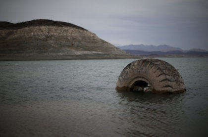 LAKE MEAD NRA, NV - MAY 13: A tractor tire sits in the waters of Lake Mead near Boulder Beach on May 13, 2015 in Lake Mead National Recreation Area, Nevada. As severe drought grips parts of the Western United States, Lake Mead, which was once the largest reservoir in …