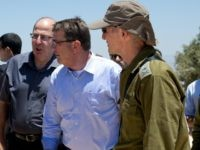 From left, Israel Defense Forces (IDF) 91st Division Commander Moni Katz, directing his right arm forward, Israeli Defense Minister Moshe Ya'alon, U.S. Defense Secretary Ash Carter and Deputy Chief of Staff Maj. Gen. Yair Golan pause as they walk from viewing Hula Valley from the Hussein Lookout, behind them, near …