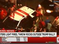 Watch: Anti-Trump Protesters In New Mexico Jump on Police Cars