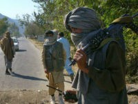 Masked Pakistani pro- Taliban militants who are supporters of Maulana Fazlullah in Pakistan's Swat valley November 2, 2007. REUTERS/SHERIN ZADA KANJU/FILES