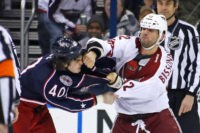 COLUMBUS, OH -MARCH 16: Paul Bissonnette #12 of the Phoenix Coyotes punches Jared Boll #40 of the Columbus Blue Jackets during a fight in the second period on March 16, 2013 at Nationwide Arena in Columbus, Ohio. (Photo by Kirk Irwin/Getty Images)