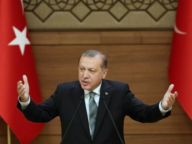 Turkish President Tayyip Erdogan gestures as he arrives to meet and speak with mukhtars or local village and town leaders at the Presidential Palace in Ankara, on May 4, 2016.