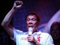 Philippine presidential candidate Rodrigo Duterte gestures during a labor day campaign rally on May 1, 2016 in Manila, Philippines.