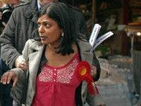 abour prospective parliamentary candidate for Ealing Central and Acton constituency Rupa Huq (R) is grabbed from behind by Karim Sacoor, a campaign volunteer for Conservative parliamentary candidate Angie Bray, as she tries to debate with London Mayor Boris Johnson as he met with voters on May 1, 2015 in London, United Kingdom.