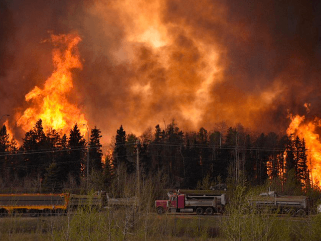 PHOTOS: Royal Canadian Mounted Police Begin to Evacuate 45,000 from Wildfire
