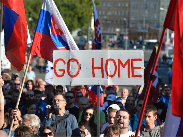Participants hold flags and a banner during an anti-immigration rally organised by an initiative called 'Stop Islamisation of Europe' and backed by the far-right 'People's Party-Our Slovakia' on September 12, 2015 in Bratislava, Slovakia. / AFP / SAMUEL KUBANI (Photo credit should read SAMUEL KUBANI/AFP/Getty Images)