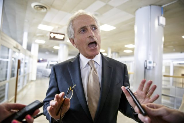 Sen. Bob Corker, R-Tenn., the ranking member of the Senate Foreign Relations Committee, speaks to reporters in the Senate subway at the Capitol in Washington, Thursday, July 31, 2014. As the U.S. Congress staggered toward a five-week summer break Thursday, it appeared legislation to send Israel millions of dollars for …