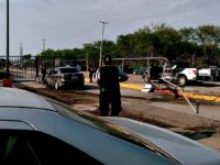 Police officer surround a vehicle with cartel gunmen inside