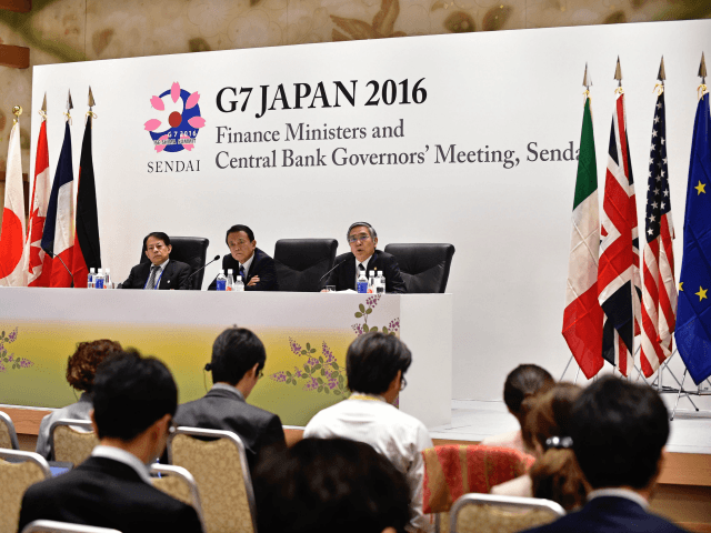 Governor of the Bank of Japan Haruhiko Kuroda (stage, R), accompanied by Japanese Finance Minister Taro Aso (stage, C) and Vice Finance Minister Masatsugu Asakawa (stage, L), answers questions during the presidency press conference after the G7 Finance Ministers and Central Bank Governors' Meeting in Sendai, northern Japan on May …