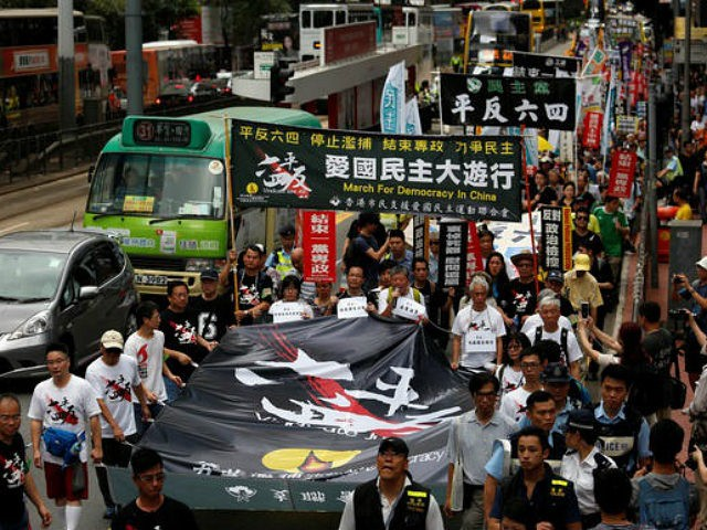 Protesters take to the streets before the 27th anniversary of the military crackdown on the pro-democracy movement at Beijing's Tiananmen Square on June 4, 1989, in Hong Kong, China May 29, 2016. © Reuters
