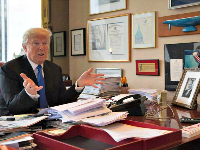 Trump at Office Desk Mary AltafferAP