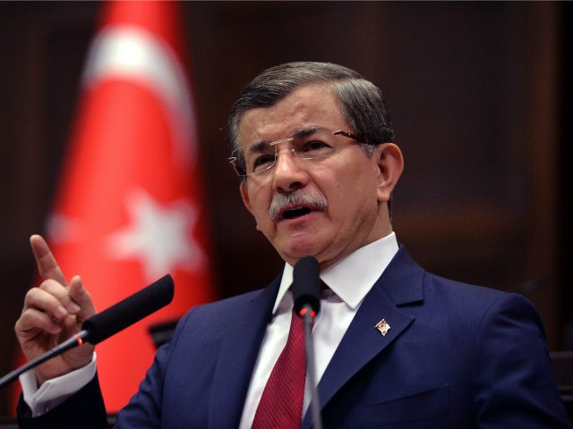 In this photo taken on Tuesday, May 3, 2016, Turkey's Prime Minister Ahmet Davutoglu addresses his lawmakers at the parliament in Ankara, Turkey. Long-denied tensions between Turkey's president Recep Tayyip Erdogan and prime minister Davutoglu are beginning to surface publicly, leading to speculation that the country's powerful leader may be considering replacing the premier with a figure more willing to take a backseat role.(AP Photo)