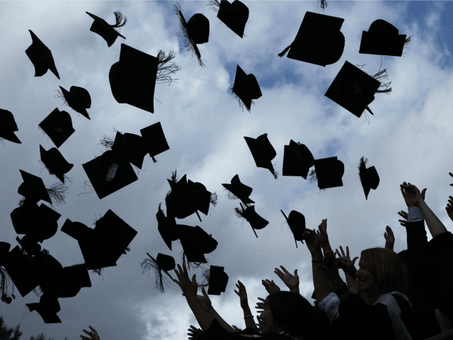 Students throw their mortarboards in the air during their graduation photograph at the University of Birmingham degree congregations on July 14, 2009 in Birmingham, England.