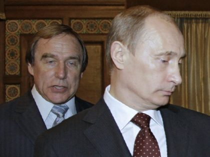 RUSSIAN FEDERATION, SAINT PETERSBURG : CORRECTION / A picture taken on November 21, 2009 shows then Russia's Prime Minister Vladimir Putin (front) and Russian cellist Sergei Roldugin, artistic director of the St. Petersburg House of Music, visiting the house, formerly a palace owned by Grand Duke Alexei Romanov, in St. …