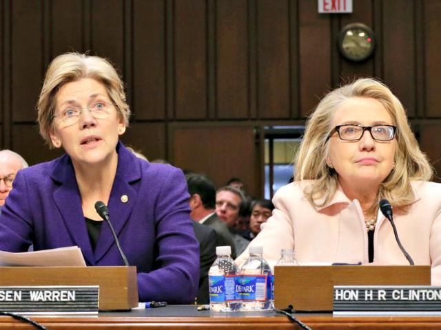 Warren and Hillary J. Scott Applewhite AP
