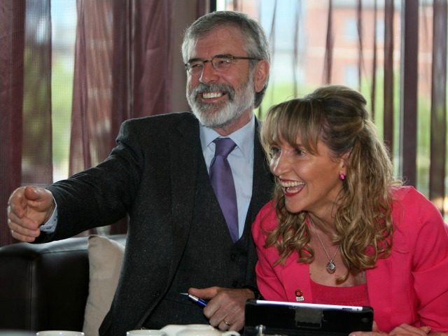 Sinn Fein President Gerry Adams (L) shares a joke with Sinn Fein European election candidate and member of the European Parliament, Martina Anderson (R), during their European Election manifesto launch in Belfast, Northern Ireland on May 12, 2014.