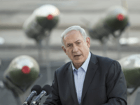 Israeli Prime Minister Benjamin Netanyahu speaks to the press at southern Israeli port of Eilat, on March 10, 2014, as Israel displayed advanced rockets type M-302 that were unloaded from the Panamanian-flagged Klos-C vessel on March 9, 2014 in Eilat.