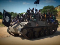 NIGERIA, Kano : A screengrab taken on November 9, 2014 from a new Boko Haram video released by the Nigerian Islamist extremist group Boko Haram and obtained by AFP shows Boko Haram fighters parading on a tank in an unidentified town. The leader of the Nigerian Islamist extremist group Boko …