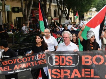 Anti-Israel demonstrators march behind a banner of the BDS organization in Marseille, June 13.. (photo credit:GEORGES ROBERT / AFP)
