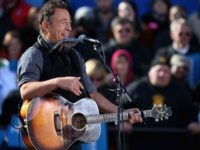 Rocker Bruce Springsteen performs during a rally for President Barack Obama on the last day of campaigning in the general election November 5, 2012 in Madison, Wisconsin.