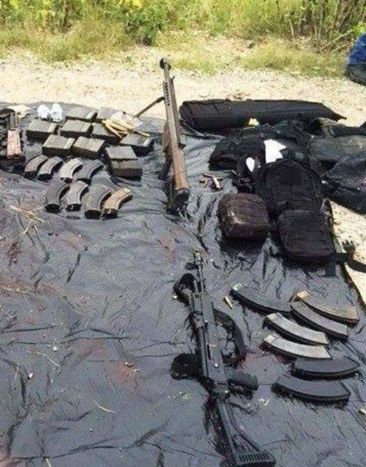 Photograph of the .50 caliber rifle and an AK-47 taken from the dead cartel gunmen after the battle.