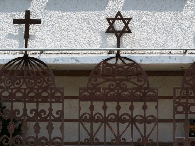 A Picture taken on April 27, 2016 shows the symbols of the three monotheistic religions, Christianity, Judaism and Islam, on the front of an Arab Jewish centre in the northern port city of Haifa. / AFP / THOMAS COEX (Photo credit should read THOMAS COEX/AFP/Getty Images)