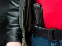'A modern, polymer (Glock), .45 caliber semiautomatic pistol in an IWB holster under a leather jacket.All images in this series...'