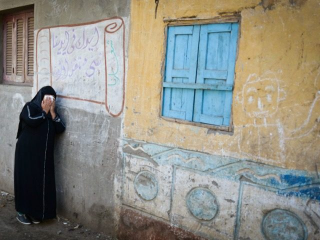 A relative of one of the Egyptian Coptic Christians purportedly murdered by Islamic State (IS) group militants in Libya reacts after hearing the news on February 16, 2015 in the village of Al-Awar in Egypt's southern province of Minya.